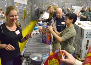 Moving food on the conveyor at Second Harvest
